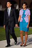 Washington, DC - July 24, 2009 -- United States President Barack Obama, left, and First Lady Michelle Obama, right, arrive at the Evening Parade at the Washington Marine Barracks on Friday, July 24, 2009.   .Credit: Kristoffer Tripplaar / Pool via CNP