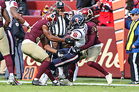 Landover, MD - November 18, 2018: Houston Texans wide receiver Keke Coutee (16) is tackled by several Washington Redskins defenders during the  game between Houston Texans and Washington Redskins at FedEx Field in Landover, MD.   (Photo by Elliott Brown/Media Images International)