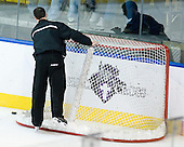 One of the officials does a more thorough check than normal of the hockey net after a puck went through the net on Friday at the East Regional. - The Boston College Eagles defeated the Yale University Bulldogs 9-7 in the Northeast Regional final on Sunday, March 28, 2010, at the DCU Center in Worcester, Massachusetts.