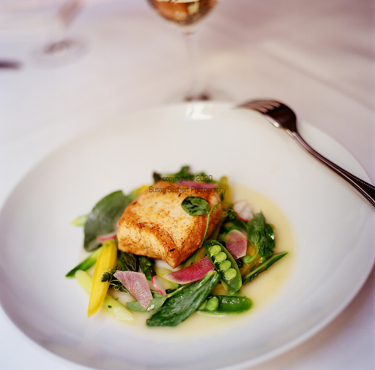 Spruce Restaurant, a bistro in Presidio Heights, purveyor of Classic California cuisine.  Pictured here is Halibut with spring vegetables from the farmers' market.