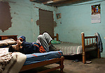 Ronald Fuentes, 9 who is both blind and deaf, waits in the bedroom he shares with his parents before making his daily 1.5 hour trip from Petrol to the Escuela de Helen Keller in Peru.