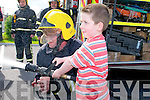 Family Fun Day : Attending the Family Fun Day at the Listowel Family Resource Centre on Sunday were Dylan Sweeney & Fireman John Sheehan.