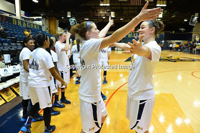 PHILADELPHIA &ndash; Before the season started, a young Drexel women's basketball team set a goal for itself to finish the regular season in the top four in the Colonial Athletic Association. Coming into play on Wednesday night, the Dragons needed a win to achieve that goal. Drexel wasted no time jumping on top of Towson on Senior Night, rolling to an 82-40 victory that locked up the No. 4 seed in the upcoming CAA Tournament.<br /> <br /> Carrie Alexander had a career high by halftime as Drexel set season highs with 42 points on 19-of-26 shooting (73.1 percent) in the first half. She finished with 14 points, matching senior Tory Thierolf for the team-high. Rachel Pearson added 12 points, going 4-for-4 from long range in the second half. Jackie Schluth added 10 points, matching her career high on 5-of-6 shooting.<br /> <br /> Senior Fiona Flanagan added nine points, hitting her first three treys of the night and finishing 3-for-4. She also had five assists and no turnovers. In all, nine different Dragons scored on the evening, with seven of them netting at least eight points. Meghan Creighton added six assists to her eight points, a team high as the Dragons dished out 27 helpers on the evening. Sarah Curran also had eight points to go along with a career-high four assists. Senior Abby Redick finished with two points, three rebounds and two assists.<br /> <br /> Drexel finished shooting a season-best 64.7 percent from the floor, hitting 33 of 51 attempts. The Dragons were also 10-for-17 from long range, including a 7-for-12 mark in the second half.<br /> <br /> The Dragons did not trail after allowing the Tigers to score the game's first points, putting Towson on top 2-0. Thierolf netted the next four for the Dragons, followed by a three-ball by Flanagan.<br /> <br /> By the 11:26 mark of the first half, Drexel was up by double digits after another trey from the senior out of Penn Valley, Pa. Flanagan has now hit 121 of her 299 career three-point attempts, good for a .405 career percentage.