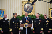United States President Barack Obama is flanked by Capt. Dan Beck, Deputy Commander of the PHS CC Ebola Response (left) Vice Admiral Vivek M. Murthy, United States Surgeon General  (second from left) Rear Admiral Boris Lushniak Officer-in-Charge of MMU Transition Between Teams (second from right) and Rear Admiral Scott F. Giberson, Commander of the PHS CC Ebola Response (right) as he meets with members of the Public Health Service Commissioned Corps (PHS CC) after signing a citation awarding the Presidential Unit Citation to PHS CC members who participated in the Ebola containment efforts in West Africa, in the Oval Office at The White House in Washington, D.C., U.S., on Thursday, Sept. 24, 2015. <br /> Credit: Rod Lamkey Jr. / Pool via CNP