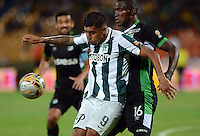 MEDELLIN - COLOMBIA -20-05-2015: Luis C Ruiz (Izq.) jugador de Atletico Nacional disputa el balón con German Mera (Der.) jugador del Deportivo Cali durante partido de ida entre Atletico Nacional y Deportivo Cali por los cuartos de final de la Liga Aguila I 2015 en el estadio Atanasio Girardot de la ciudad de Medellin. / Luis C Ruiz (L) player of Atletico Nacional fights for the ball with German Mera (R) playerof Deportivo Cali during a match between Atletico Nacional and Deportivo Cali for the first leg of the quarterfinals of the Liga Aguila I 2015 at the Atanasio Girardot stadium in Medellin city. Photos: VizzorImage  / Leon Monsalve / Str.