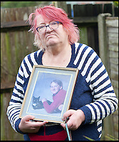 BNPS.co.uk (01202) 558833<br /> Picture: LauraJones/BNPS<br /> <br /> Pamela Young pictured with a photo of her son Andrew Young.<br /> <br /> Andrew Young, 40, became embroiled in an argument with Victor Ibitoye after he blasted him for riding his bike on the pavement.Just seconds after the altercation Mr Young was approached by Mr Ibitoye's friend, Lewis Gill, who launched a horrific attack on the Asperger's Syndrome sufferer.Shocking CCTV footage shows Gill, aged 20, throw a punch at Mr Young that was so forceful he was flung off the pavement and onto the road, striking his head.The callous thug is then seen walking away from the man as he lay lifeless on the ground.He was rushed from the scene in Bournemouth, Dorset, to Southampton General Hospital in Hampshire where he died the next day.A post mortem found no injuries to suggest that the vulnerable victim had tried to defend himself.Gill pleaded guilty to one count of manslaughter at Salisbury Crown Court and was jailed for four years and six months.