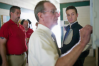 French jockey Julien Leparoux (R) gets weighed by the assistant clerk (2R) as race staff look on before a race in Saratoga Springs, NY, United States, 4 August 2006.<br />
