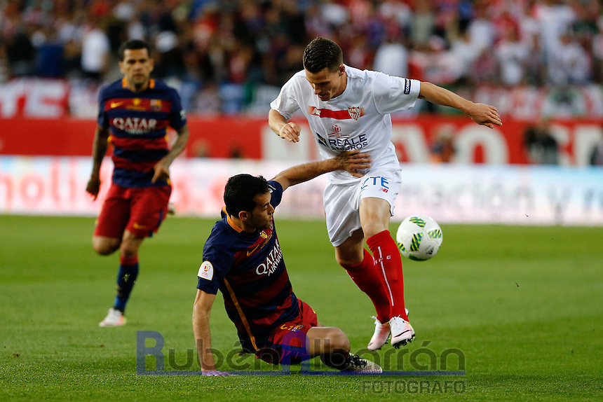 FC Barcelona´s  midfielder Sergio Busquets and Sevilla´s forward Gameiro during the Final of Copa del Rey match between FC Barcelona and SevillaFC at the Vicente Calderon Stadium in Madrid, Sunday, May 22, 2016.