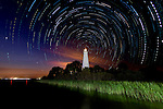 Photographs of the Saint Marks Lighthouse in the St Marks National Wildlife Refuge in Wakulla County, Florida shot from the Gulf of Mexico.  The time exosures show the stars circulating around the north star behind the lighthouse.