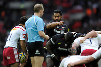 Billy Vunipola of Saracens makes a point to referee Wayne Barnes