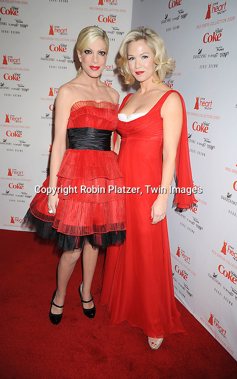 Tori Spelling in Betsy Johnson dress and Jennie Garth in ..Badgley Mischka dress..at The Heart Truth's Red Dress Fashion Show on February 12, 2009 at Mercedes Benz FAshion Week. Swarovski was one of the sponsers for this show. ....Robin Platzer, Twin Images