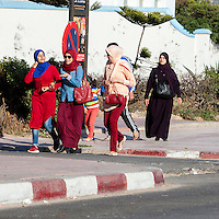 Essaouira, Morocco.  Moroccan Women in Varying Clothing Styles.