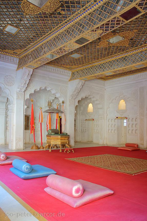 palace of Fort Mehrangarh,  Jodhpur, Rajastan, India - throne and magenta-coloured carpet