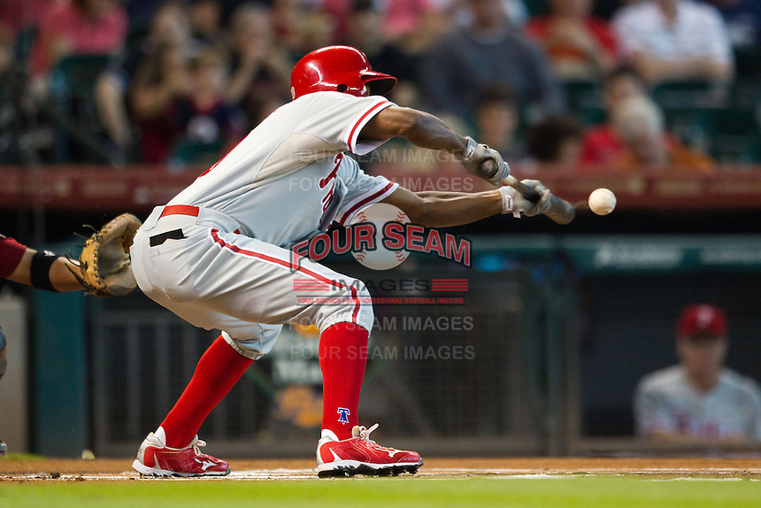 Philadelphia Phillies outfielder Juan Pierre #10 lays down a first inning sacrifice bunt during the Major League baseball game against the Houston Astros on September 16th, 2012 at Minute Maid Park in Houston, Texas. The Astros defeated the Phillies 7-6. (Andrew Woolley/Four Seam Images).