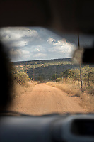 View of dirt road in savannah seen from inside of car in Lubombo Region, Eswatini