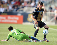 Sebastien Le Toux #9 of the Philadelphia Union loses the ball to a sliding tackle from James Riley #7 of the Seattle Sounders FC during the first MLS match at PPL stadium in Chester, PA. on June 27 2010. Union won 3-1.