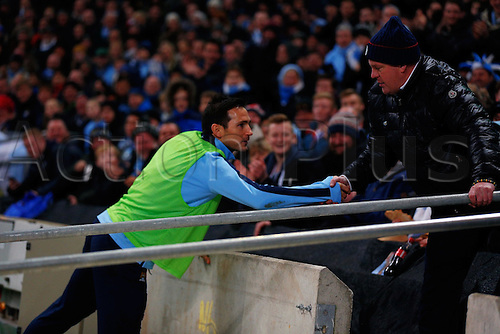 06.12.2014.  Manchester, England. Premier League. Manchester City versus Everton. Manchester City midfielder Frank Lampard enters the crowd mid-match to shake hands with a supporter