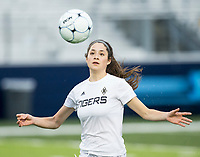 NWA Democrat-Gazette/BEN GOFF @NWABENGOFF<br /> Angelina Diaz of Bentonville chases down the ball Tuesday, March 12, 2019, during the match vs Springdale Har-Ber at Wildcat Stadium in Springdale.