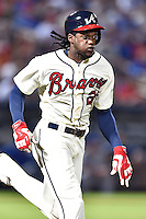 Atlanta Braves center fielder Cameron Maybin (25) runs to first during a game against the Chicago Cubs on July 18, 2015 in Atlanta, Georgia. The Cubs defeated the Braves 4-0. (Tony Farlow/Four Seam Images)