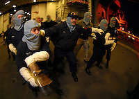 070320-N-7981E-374 Naval Base Kitsap Bremerton (March 20, 2007)- Aviation Boatswain's Mate (Handling) 1st Class Alton Keith leads a hose team into a simulated fire during a general quarters drill in the hangar bay of the Nimitz-class aircraft carrier USS Abraham Lincoln (CVN-72). Lincoln held ship-wide drills throughout the day as part of a simulated underway in preparation for the ship's return to operational status following a Dry-dock Planned Incremental Availability period at Puget Sound Naval Shipyard. U.S. Navy photo by Mass Communication Specialist 3rd Class James R. Evans (RELEASED)