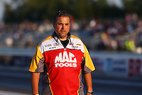 Aug 15, 2014; Brainerd, MN, USA; Jim Oberhofer crew chief for NHRA top fuel dragster driver Doug Kalitta (not pictured) during qualifying for the Lucas Oil Nationals at Brainerd International Raceway. Mandatory Credit: Mark J. Rebilas-