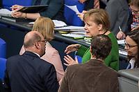 Sitzung des Deutschen Bundestag am Donnerstag den 21. Februar 2019.<br /> Im Bild: Martin Schulz, SPD, im Gespraech mit Bundeskanzelrin Angela Merkel, CDU.<br /> 21.2.2019, Berlin<br /> Copyright: Christian-Ditsch.de<br /> [Inhaltsveraendernde Manipulation des Fotos nur nach ausdruecklicher Genehmigung des Fotografen. Vereinbarungen ueber Abtretung von Persoenlichkeitsrechten/Model Release der abgebildeten Person/Personen liegen nicht vor. NO MODEL RELEASE! Nur fuer Redaktionelle Zwecke. Don't publish without copyright Christian-Ditsch.de, Veroeffentlichung nur mit Fotografennennung, sowie gegen Honorar, MwSt. und Beleg. Konto: I N G - D i B a, IBAN DE58500105175400192269, BIC INGDDEFFXXX, Kontakt: post@christian-ditsch.de<br /> Bei der Bearbeitung der Dateiinformationen darf die Urheberkennzeichnung in den EXIF- und  IPTC-Daten nicht entfernt werden, diese sind in digitalen Medien nach §95c UrhG rechtlich geschuetzt. Der Urhebervermerk wird gemaess §13 UrhG verlangt.]