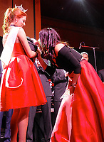 NWA Democrat-Gazette/JOCELYN MURPHY<br /> Julie Joyce, winner of the High Hoof award at the Kiss a Pig Gala for the American Diabetes Association, gets to kiss Roxy P. Hamilton during the 15th annual event on March 11 at the John Q. Hammons Center in Rogers.