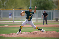 Oakland Athletics starting pitcher Jesus Luzardo (54) delivers a pitch to the plate during a Minor League Spring Training game against the Chicago Cubs at Sloan Park on March 13, 2018 in Mesa, Arizona. (Zachary Lucy/Four Seam Images)