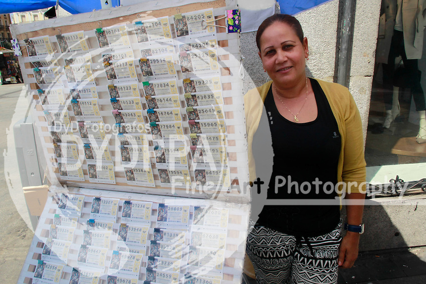 Arelis poses with her lottery tickets