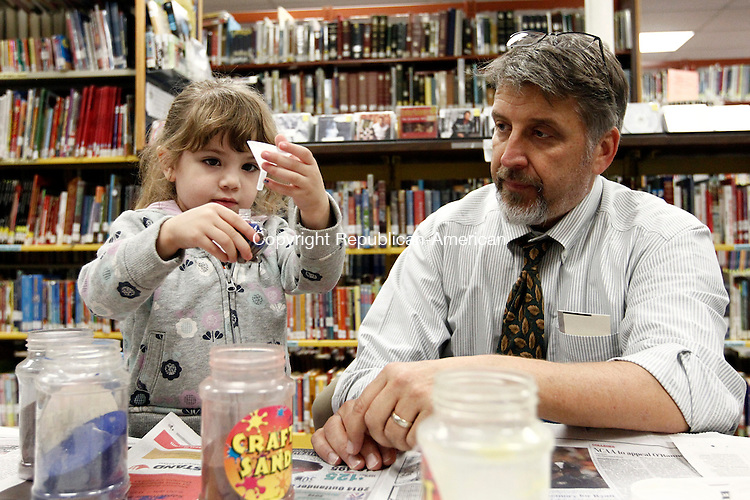 Oxford, CT- 22 September 2014-092214CM04-  Kaylii Blasavage, 3, of Oxford makes a sand art necklace with her grandfather Mike Blasavage, at the Oxford Public Library on Monday.  Various colors of sand were used to create the necklaces, part of the library's craft day, which runs on Mondays.  Events are held from 3 p.m. until 6 p.m. and is open to all ages, said children's' librarian Marissa Ciullo.  The month of October however will feature Spooky Science days which will be held on Monday's from 3:30p.m. until 5:30 p.m.  Christopher Massa Republican-American