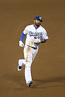 Los Angeles Dodgers outfielder Matt Kemp #27 runs the bases during a game against the Pittsburgh Pirates at Dodger Stadium on September 17, 2011 in Los Angeles,California. Los Angeles defeated Pittsburgh 6-1.(Larry Goren/Four Seam Images)