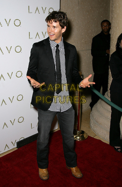 "RYAN KWANTEN.""True Blood"" Star Ryan Kwanten Celebrates His Birthday at Lavo Inside the Palazzo Resort Hotel and Casino, Las Vegas, Nevada, USA..November 28th, 2009.full length black jacket jeans denim white check shirt tie hands .CAP/ADM/MJT.© MJT/AdMedia/Capital Pictures."