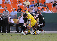 Columbus Crew forward Guillermo Barros Schelotto (7) gets fouled by DC United defender Julius James (2).  The Columbus Crew defeated DC united 1-0, at RFK Stadium, Saturday September 4, 2010.