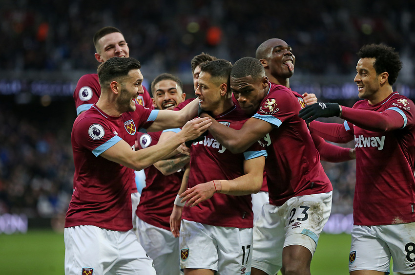 West Ham United's Javier Hernandez celebrates scoring his side's fourth goal with his team mates<br /> <br /> Photographer Rob Newell/CameraSport<br /> <br /> The Premier League - West Ham United v Huddersfield Town - Saturday 16th March 2019 - London Stadium - London<br /> <br /> World Copyright © 2019 CameraSport. All rights reserved. 43 Linden Ave. Countesthorpe. Leicester. England. LE8 5PG - Tel: +44 (0) 116 277 4147 - admin@camerasport.com - www.camerasport.com