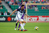 25th March 2018, nib Stadium, Perth, Australia; A League football, Perth Glory versus Melbourne Victory; Rhys Williams of Melbourne Victory passes the ball in front of Andy Keogh of the Perth Glory during the first half