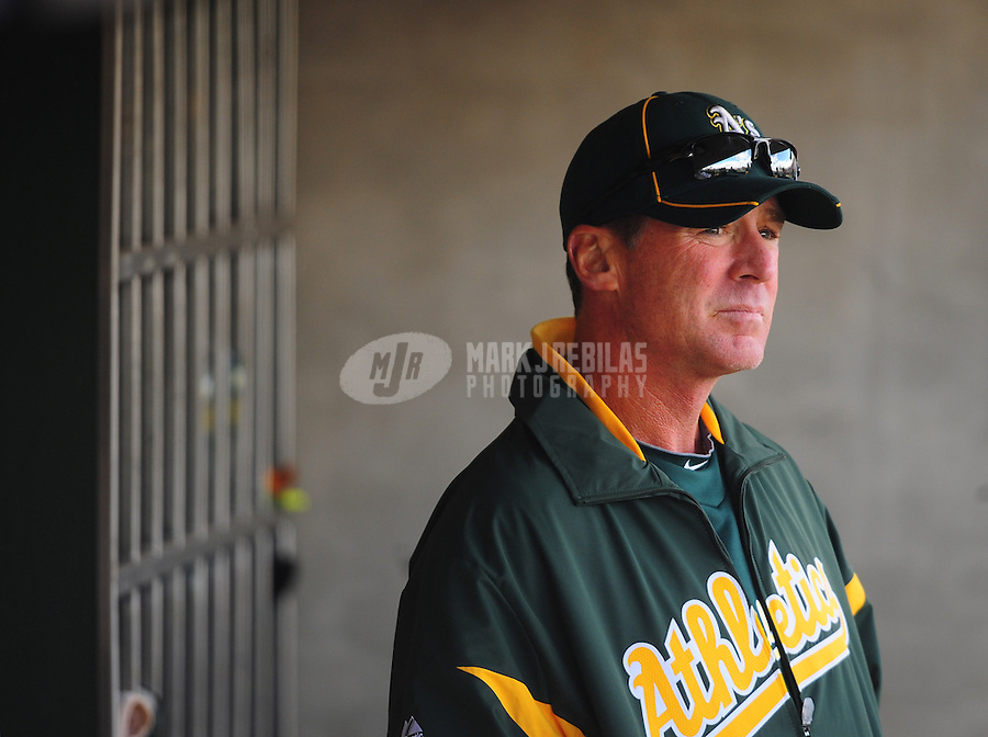 Mar. 19, 2012; Phoenix, AZ, USA; Oakland Athletics manager Bob Melvin in the fourth inning against the Arizona Diamondbacks during a spring training game at Phoenix Municipal Stadium.  Mandatory Credit: Mark J. Rebilas-
