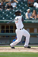 Ivan De Jesus Jr. (12) of the Charlotte Knights follows through on his swing against the Durham Bulls at BB&T BallPark on May 27, 2019 in Charlotte, North Carolina. The Bulls defeated the Knights 10-0. (Brian Westerholt/Four Seam Images)