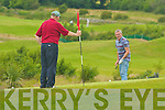 John Dineen going for the putt on the 7th as Mike Joe Quinnlan holds the flag in the Ballyheigue Castle Golf Club Captain's Prize on Sunday.   Copyright Kerry's Eye 2008
