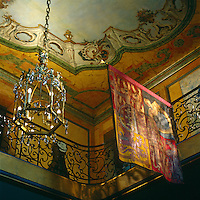 In the entrance hall the trompe l'oeil sky of the painted ceiling seems to soar to infinity and the ceiling lantern, decorated with Prince of Wales feathers, is from the Duke's Fort Belvedere house; the banner is from his stall in St George's chapel, Windsor