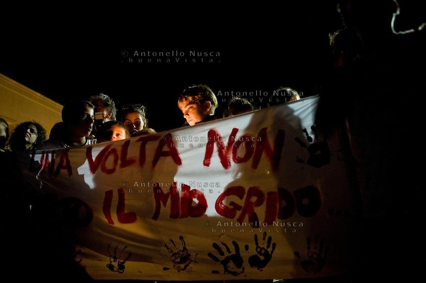 La popolazione di Lampedusa durante la fiaccolata per commemorare le vittime del naufragio. People attend the torchlight procession in memory of victims of the immigrant boat disaster in Lampedusa, Italy.