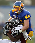 BROOKINGS, SD - NOVEMBER 6: Michael Lien #45 of South Dakota State University brings down Chris Douglas #4 of Missouri State in the second quarter of their game Saturday afternoon at Coughlin Alumni Stadium in Brookings. (photo by Dave Eggen/Inertia)