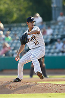 "Charleston Riverdogs pitcher Alex Mauricio (21) on the mound during a game against the Hickory Crawdads at the Joseph P. Riley Ballpark in Charleston, South Carolina. For Sunday games, the Riverdogs wear their ""Holy City"" uniforms in honor of the city's nickname. Hickory defeated Charleston 8-7. (Robert Gurganus/Four Seam Images)"