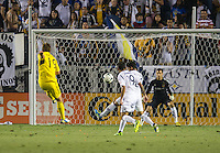 CARSON, CA - July 4, 2013: Columbus Crew midfielder Konrad Warzycha (19) takes a shot on goal at LA Galaxy goalkeeper Carlo Cudicini (1) during the LA Galaxy vs Columbus Crew match at the StubHub Center in Carson, California. Final score, LA Galaxy 2, Columbus Crew 1.