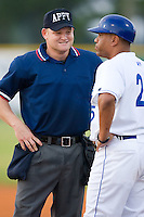 Home plate umpire Jonathan Bailey and Burlington Royals hitting coach Omar Ramirez (25) chat at Burlington Athletic Park in Burlington, NC, Wednesday, August 13, 2008. (Photo by Brian Westerholt / Four Seam Images)