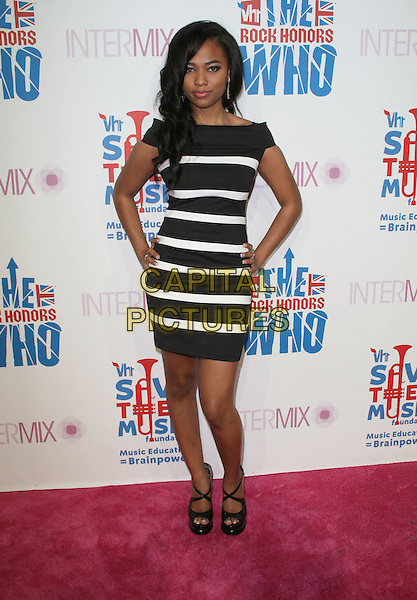 TEAIRRA MARI.Intermix's 3rd Annual VH1 Rock Honors VIP Party held at Intermix Boutique, Los Angeles, California, USA..July 11th, 2008.full length black white striped stripes dress hands on hips.CAP/ADM/FS.©Faye Sadou/AdMedia/Capital Pictures.