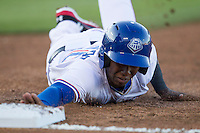 Round Rock Express shortstop Jurickson Profar #10 dives back to first base during a pick off attempt by the Omaha Storm Chasers in the Pacific Coast League baseball game on April 4, 2013 at the Dell Diamond in Round Rock, Texas. Round Rock defeated Omaha in their season opener 3-1. (Andrew Woolley/Four Seam Images).