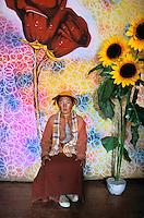 Monk in photo studio, Litang, Kham, Tibet ,2005.