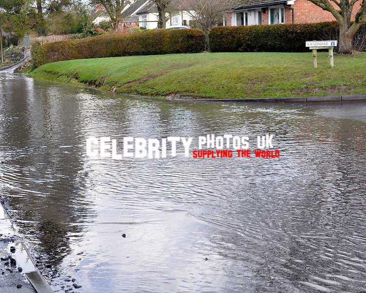 Natural underground spring floods into roads in Aldbourne, WIltshire, 13/1/12 January 2013 photo by graham finney