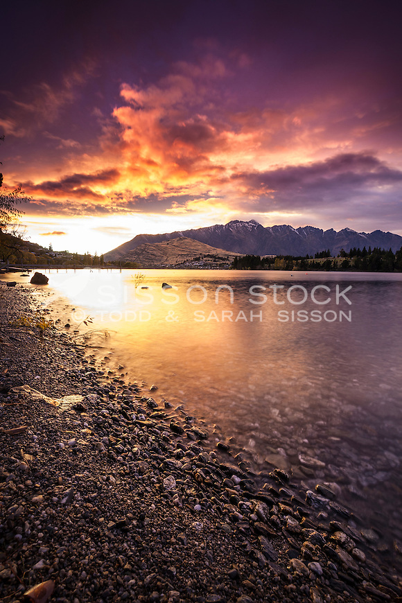 Sunrise at lakes edge looking towards the Remarkables Mountains, Lake Wakatipu, Queenstown, South Island, New Zealand - stock photo, canvas, fine art print