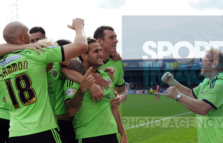Billy Sharp of Sheffield United celebrates scoring his goal to make it 2-0 with a Sheffield United supporter (right)<br /> - Sky Bet League One - Swindon Town vs Sheffield United - The County Ground - Swindon - England - 29th August 2015 - <br /> --------------------